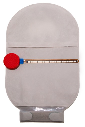 An ostom-i Alert Sensor in place on a 300ml stoma bag